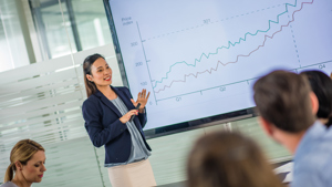 Woman presenting financial graph