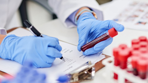 Researcher assessing blood vials