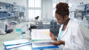Female researcher checking guidance in a lab