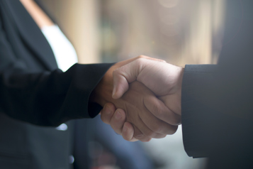 Handshake between a man and a woman